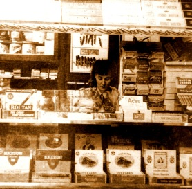 My mother at work in a cigar store sometime during wartime.